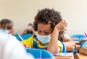 African American child with mask at school