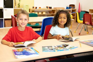 two students reading books from Exploring Reading