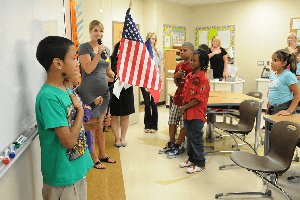 Elementary children saying the pledge of allegiance in classroom