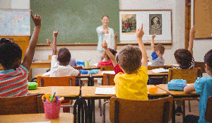 teacher student who is raising their hands
