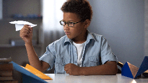 African American Boy with paper airplane