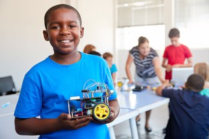 boy holding robotic car